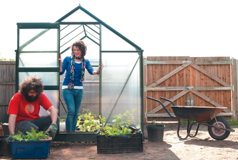 Male and female postgraduate students working in the University Park allotment