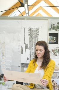 Undergraduate student working on coursework in The Studio, Architecture and Built Environment Building