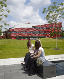 Students sittng infront of Administration Building, Jubilee Campus