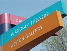 Image of a signpost pointing to Weston Gallery and Djanogly Theatre