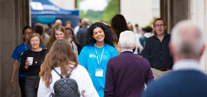 Student helper and visitors walking through the Trent Building courtyard on an open day at the University of Nottingham