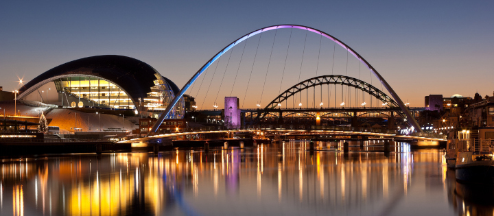 Bridge over river in Newcastle at dusk