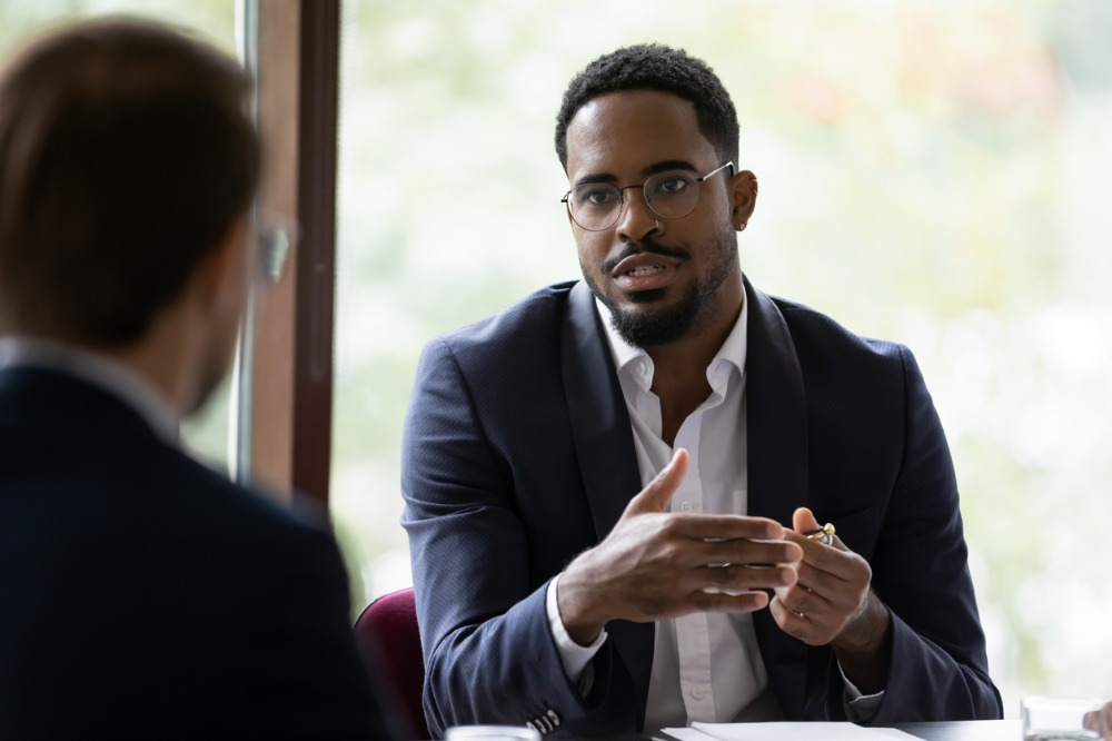 A male talking with colleague in an office