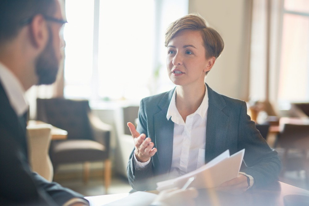 A woman giving advise to a male colleague