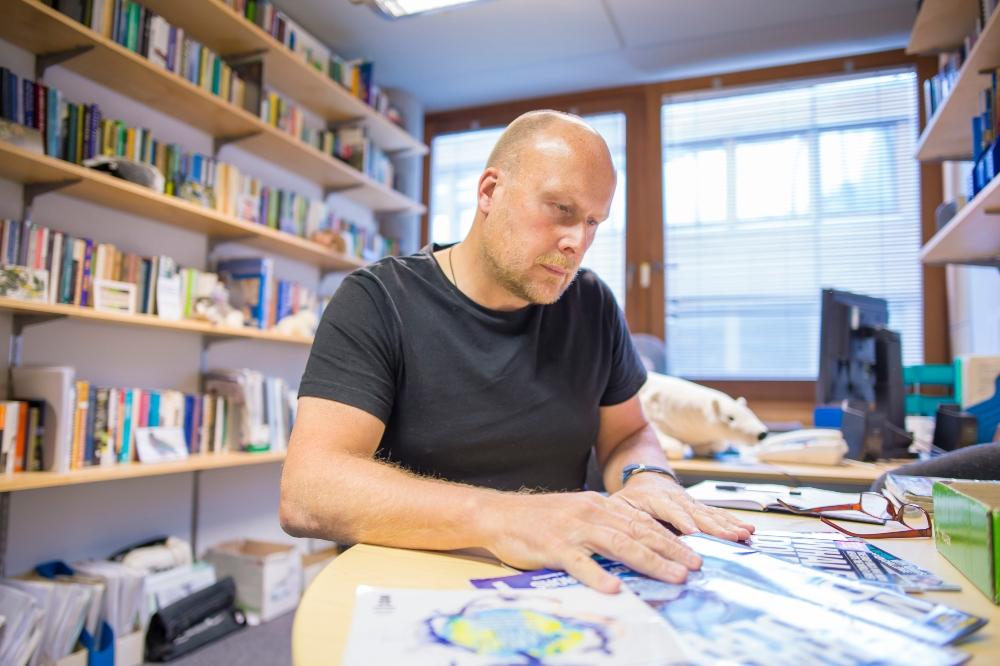 Rob Lambert working at a desk
