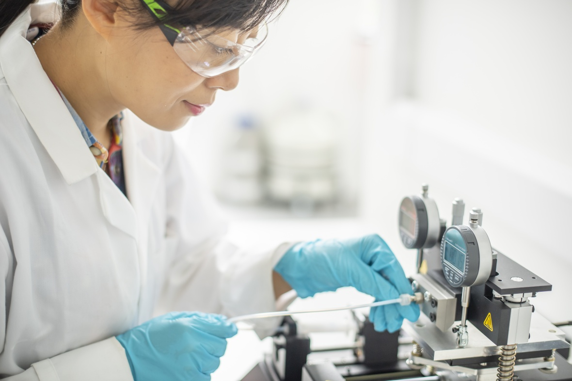 Female scientist researcher working in a lab environment