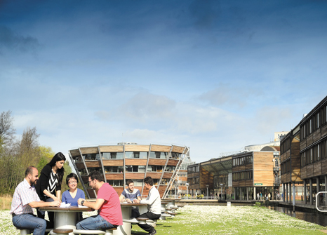Postgraduate-students-relaxing-in-front-of-the-Learning-Resource-Centre,-Jubilee-campus