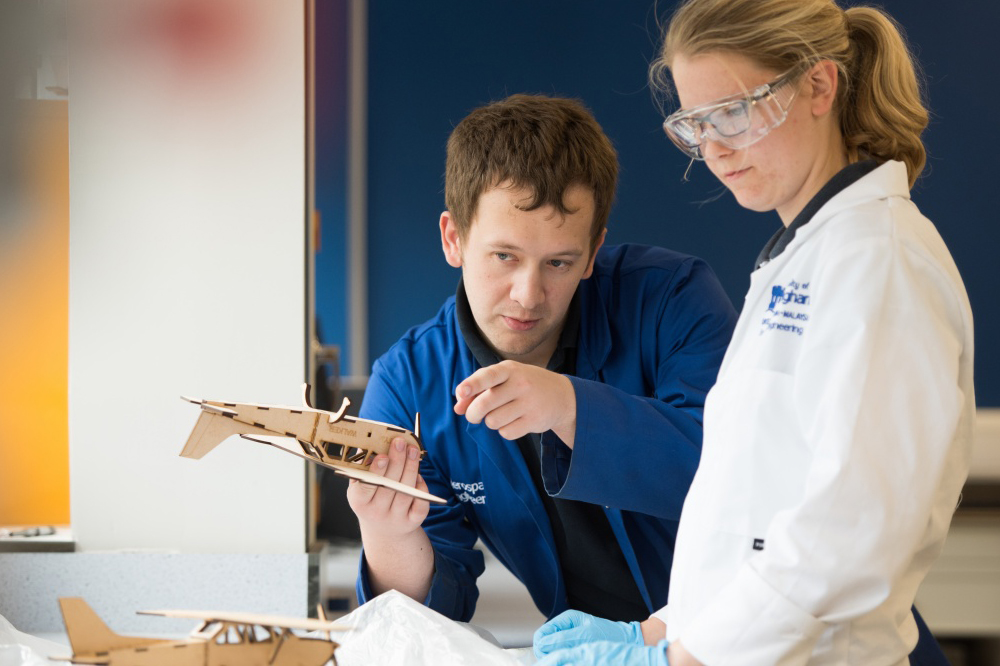 Student and technician in workshop