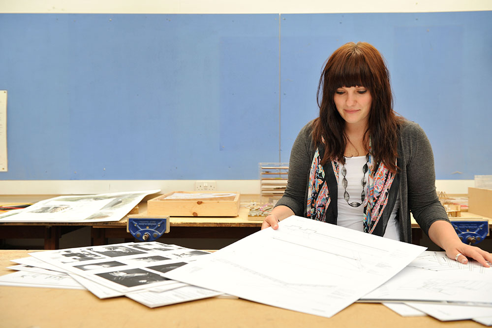 Student working in a design studio using a sketch pad.