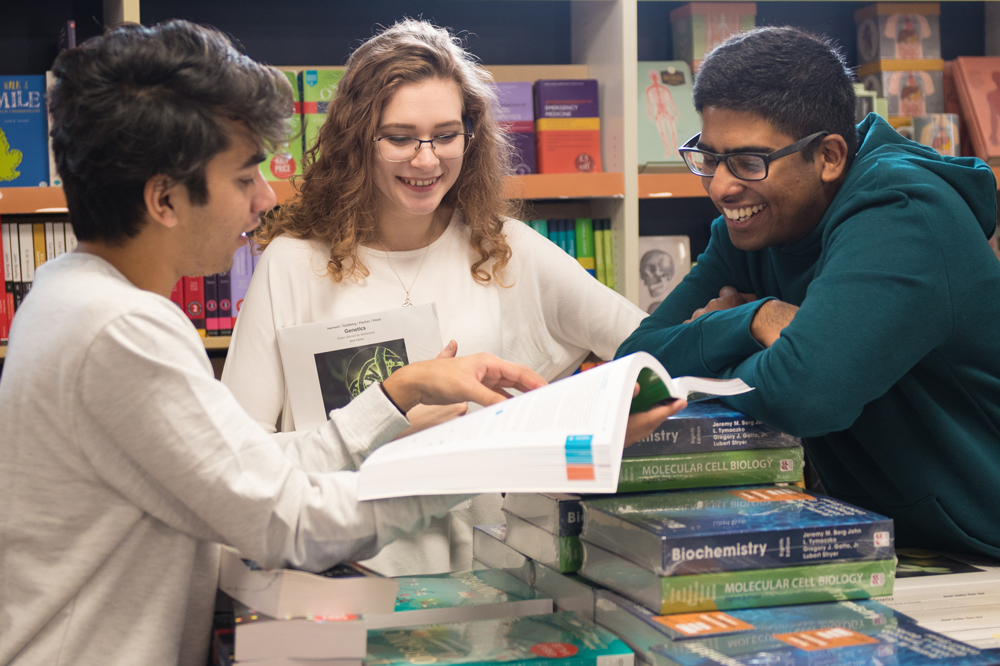 A group of students browsing in Blackwell's bookshop