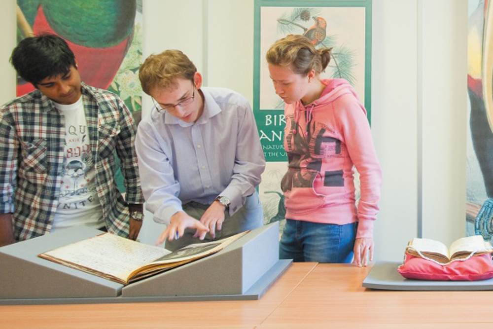 Three students at Manuscripts and Special Collections