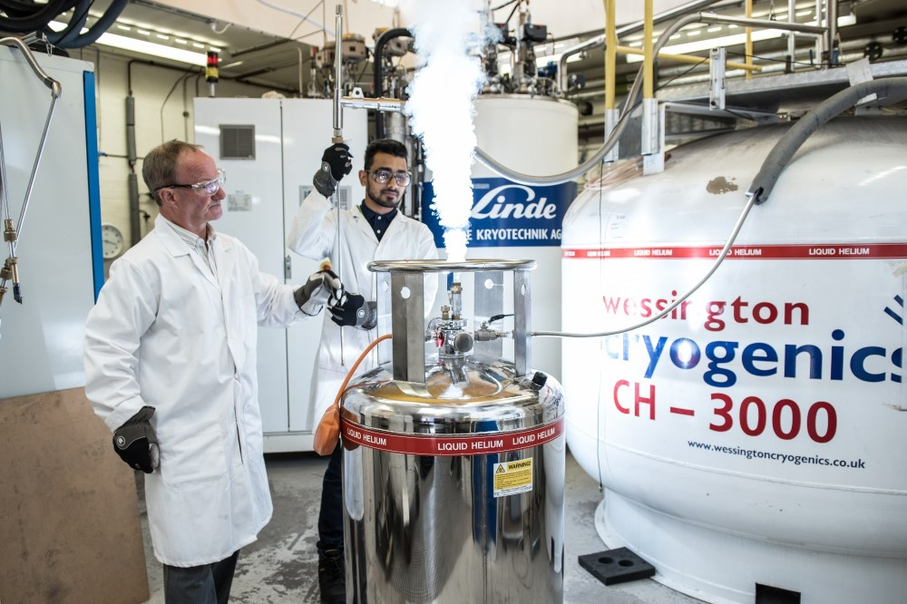 A senior and trainee technician working with cryogenics
