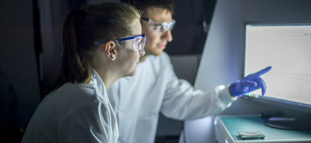 Two undergraduate students in a lab