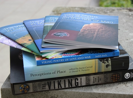 Pile of books and journals about the Vikings stacked on top of a stone plinth (photo)