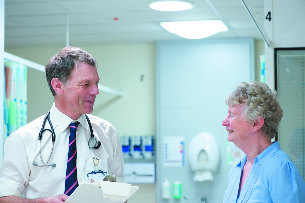 Professor John Atherton - Head of the School of Clinical Sciences with patient in QMC.