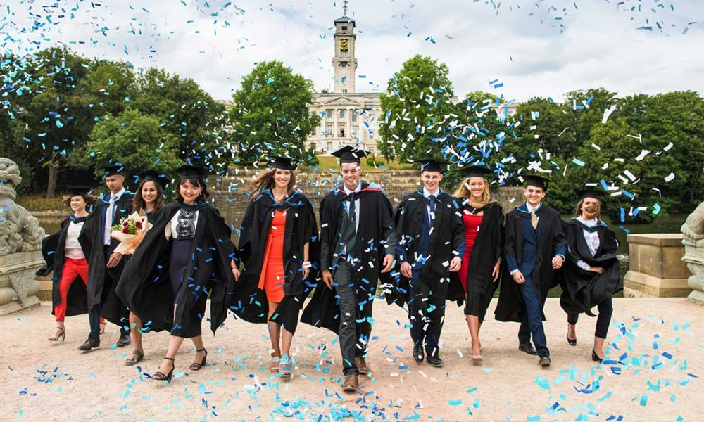 Graduates in front of Trent Building, Summer Graduation 2018, Highfields Lake